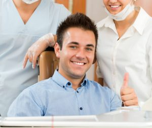 Happy patients treat gum disease with the help of our Placerville dentists and Perio Protect.